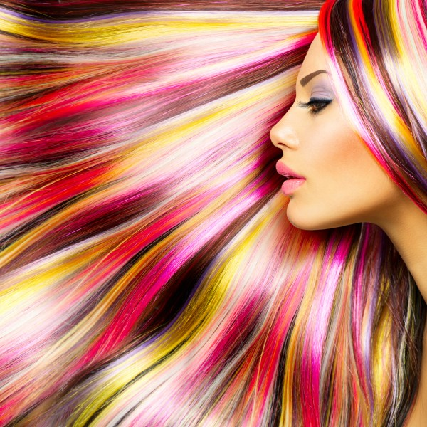 Beauty Fashion Model Girl with Colorful Dyed Hair. Colourful Lon